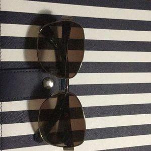 Diane von Furstenbrrg purple sunglasses